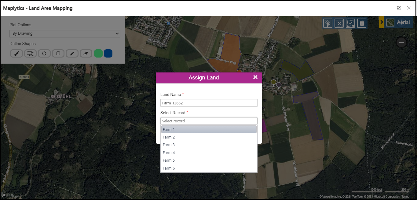 Once you plot the region, you need to select the region by selection tool and right-click on the selected region. Then you will see the Assign Land button. Once the user clicks on the Assign Land button, the below screen will be displayed, where you need to select/fill the geography name and in lookup select respective record for which you want to assign the land area. You can assign land to multiple records also by selecting them from the home grid and then click on Land Area Mapping from the ribbon bar.